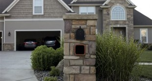 The Kalamazoo County Road Commission sent letters to 25 residents of Texas Township, Mich. telling them they need to take down their stone mailboxes. The letters said they cause a driving hazard. (Daytona Niles/Kalamazoo Gazette via AP) ALL LOCAL TV OUT AND LOCAL TV INTERNET OUT